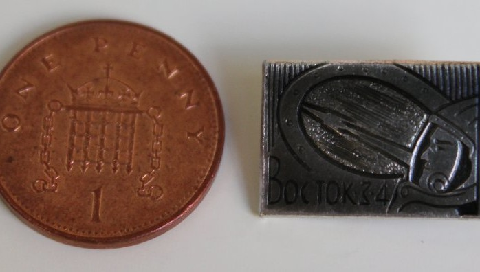Size scale next to One Penny